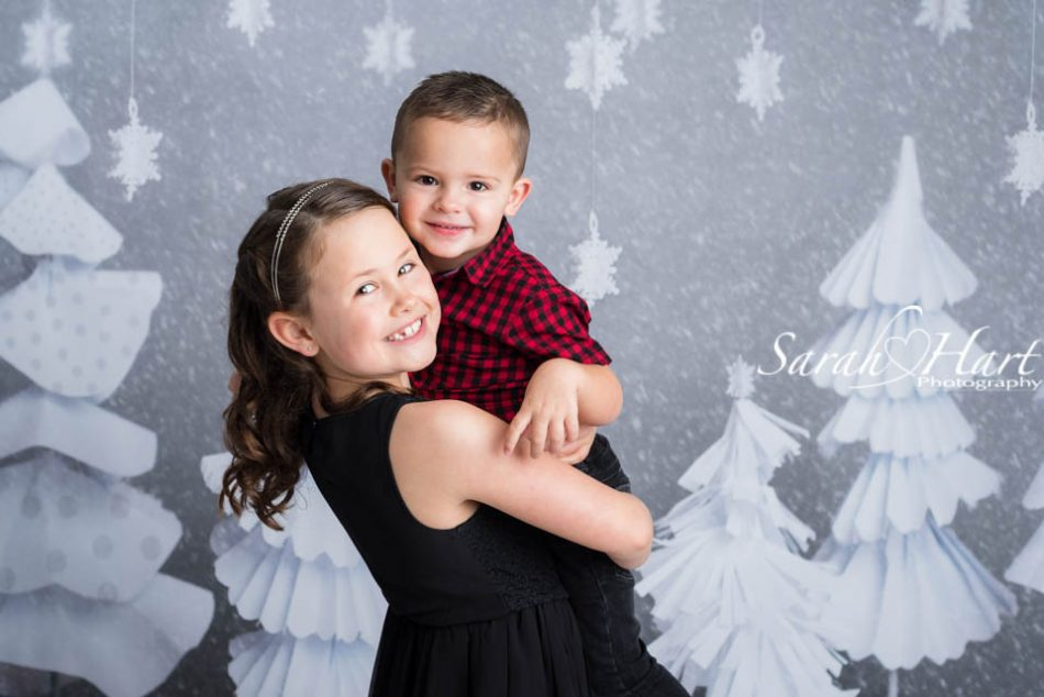 Christmas photo session, grey and white snow scene, brother and sister