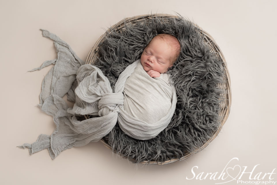 newborn in a basket, creative newborn photography