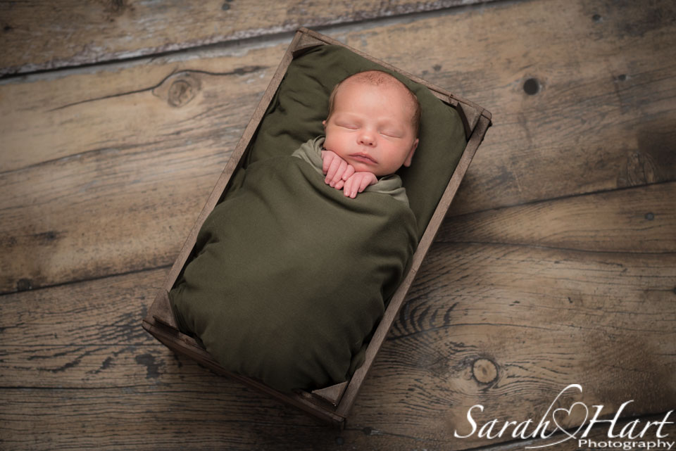 newborn in a crate, artistic newborn photography