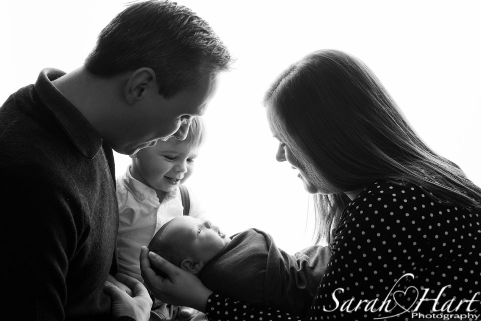 family silhouette shot, styled newborn photoshoot