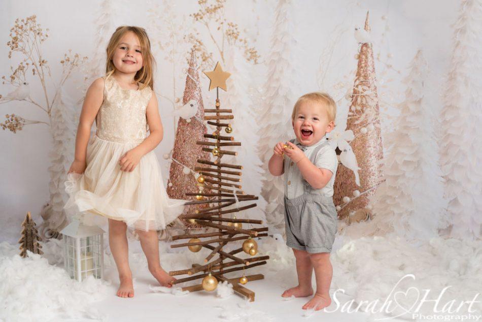 Siblings laughing at their Xmas mini photoshoots