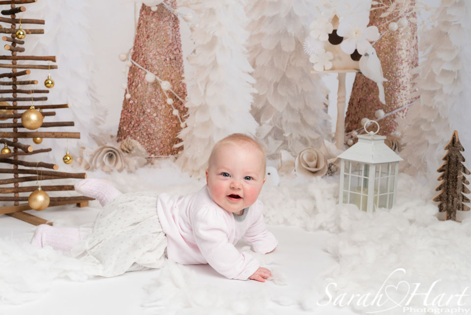 baby girl in fake snow, Xmas mini session, edenbridge family photographer