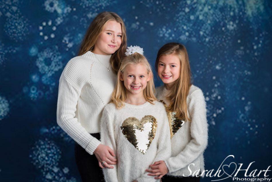 navy backdrop, Christmas image of sisters