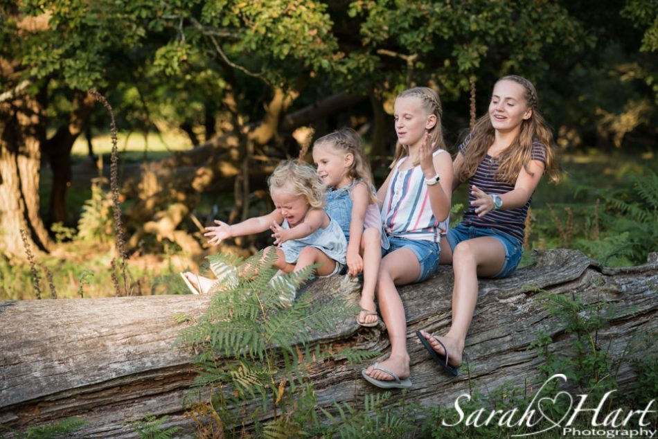 Little sister not happy on a family photo shoot