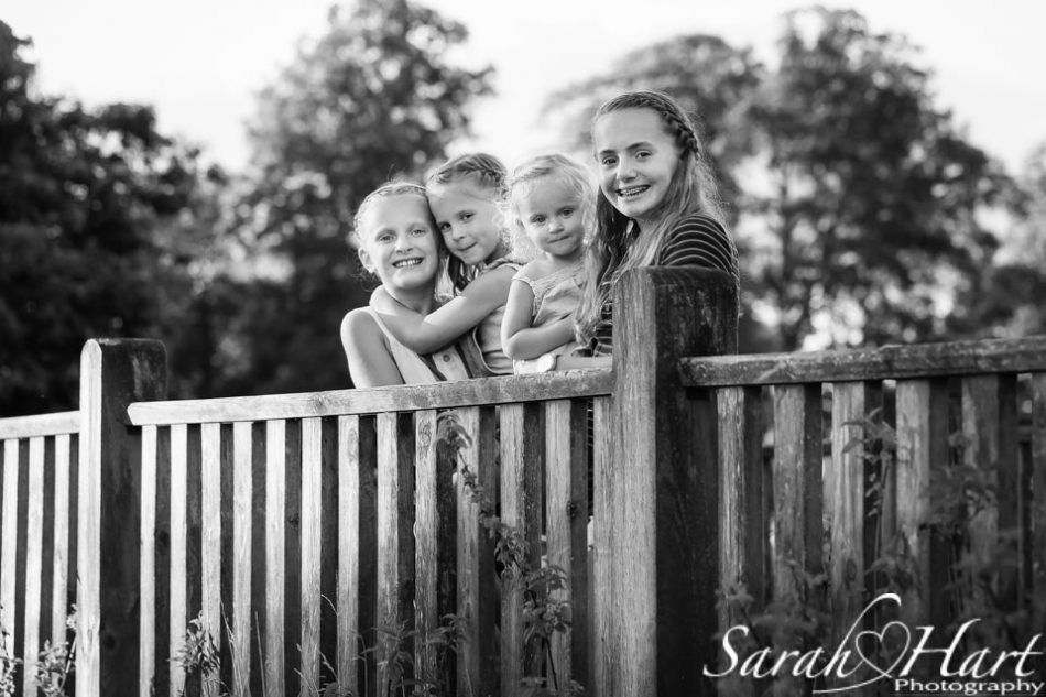 Black and white image of sister by Tunbridge Wells family photographer
