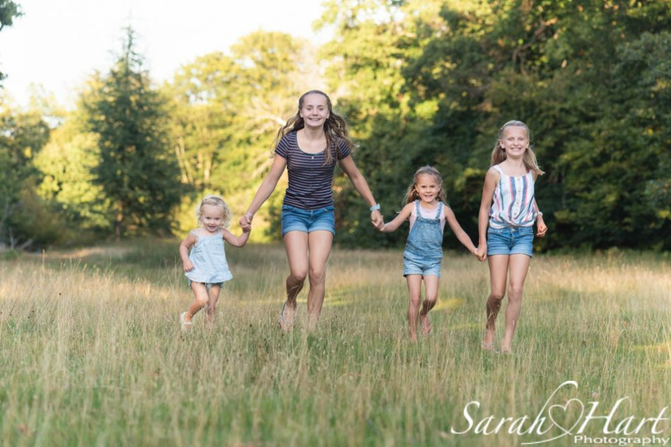Sisters being photographed by Kent family photographer