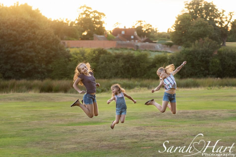 jumping for joy in Kent countryside, photo by Sarah Hart Photography