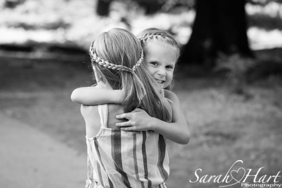 Sisterly hugs at Knole Park on family photography session