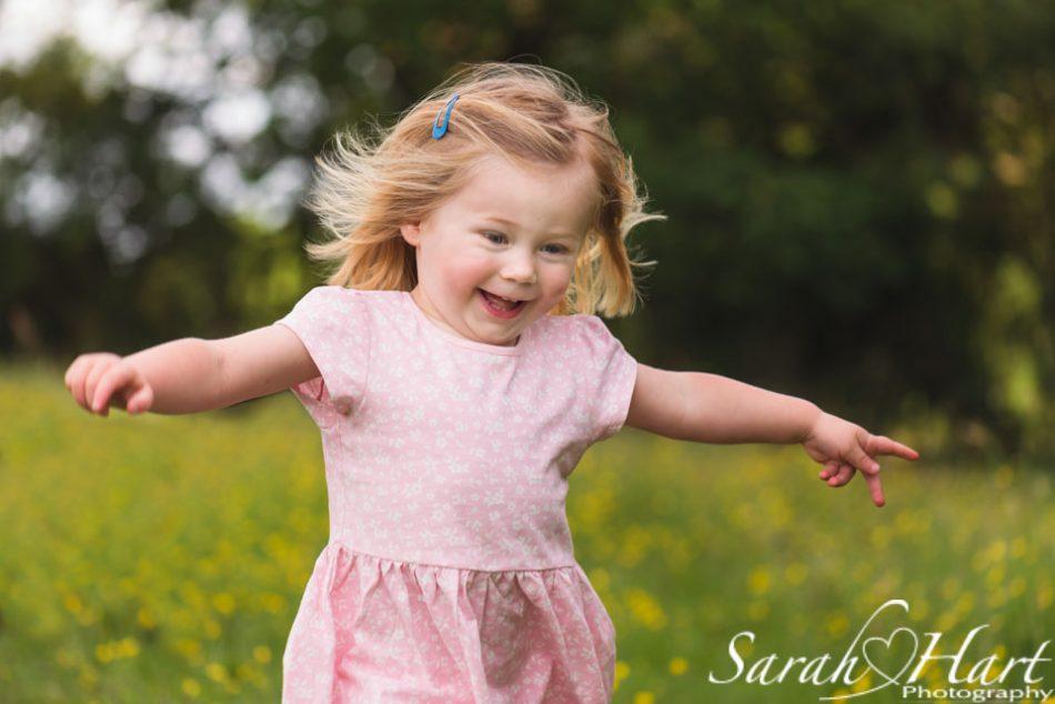 girl running through flowers, family photographer, kent
