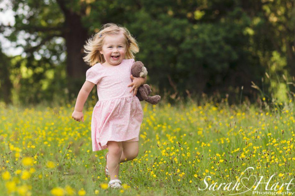 girl running through flowers, sevenoaks family photographer