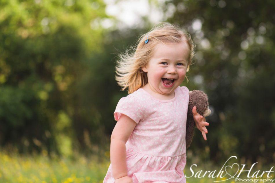 girl running through flowers, tunbridge wells family photographer