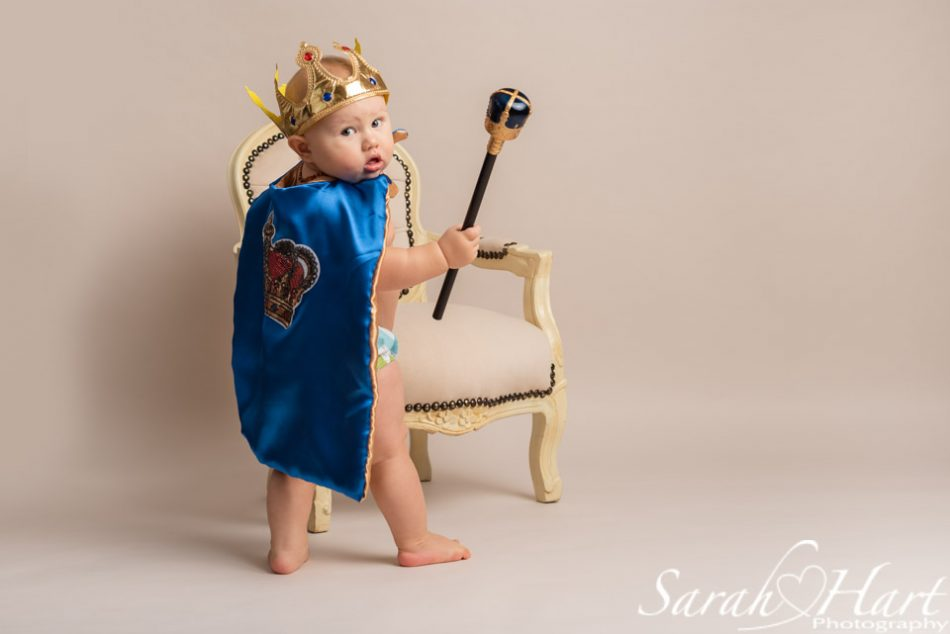 Little boy dressed up as a king for his cake smash
