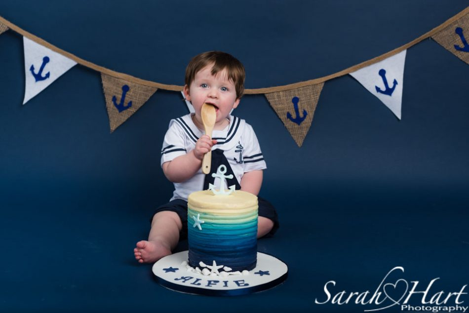 Kent baby photographer takes images of little sailor boy at his cake smash