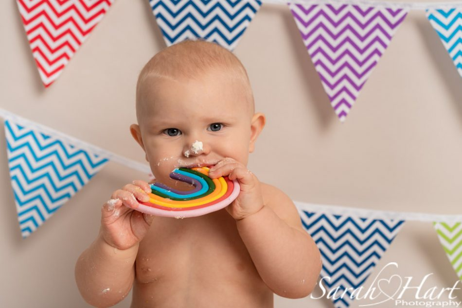 Boy eating rainbow at his rainbow baby cake smash, Tonbridge photographer