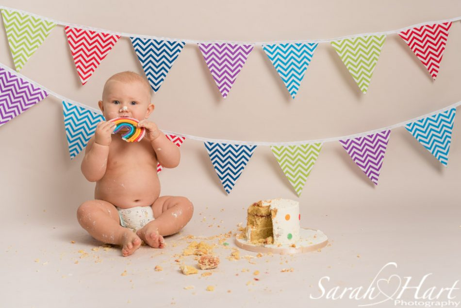 Rainbow baby cake smash photography shoot by Tonbridge photographer, Sarah Hart Photography