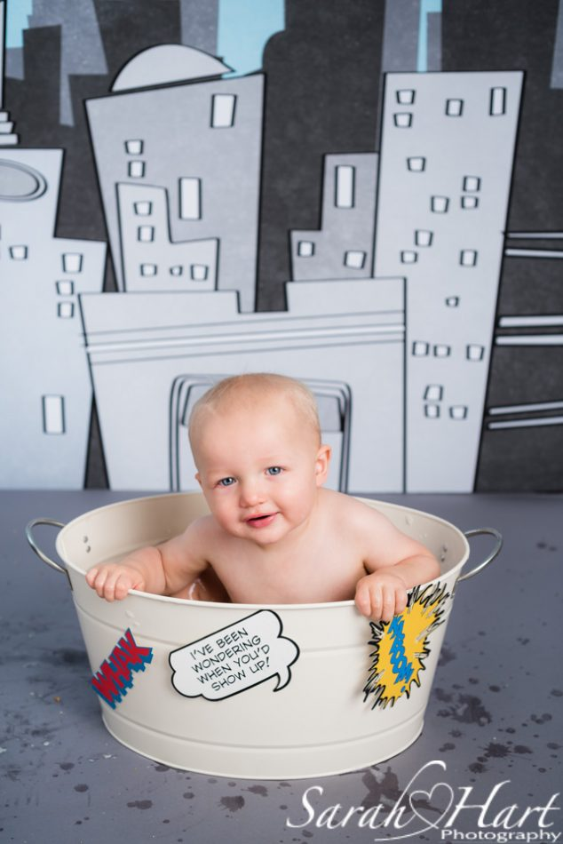 Boy in his superhero bath tub at a cake smash session kent