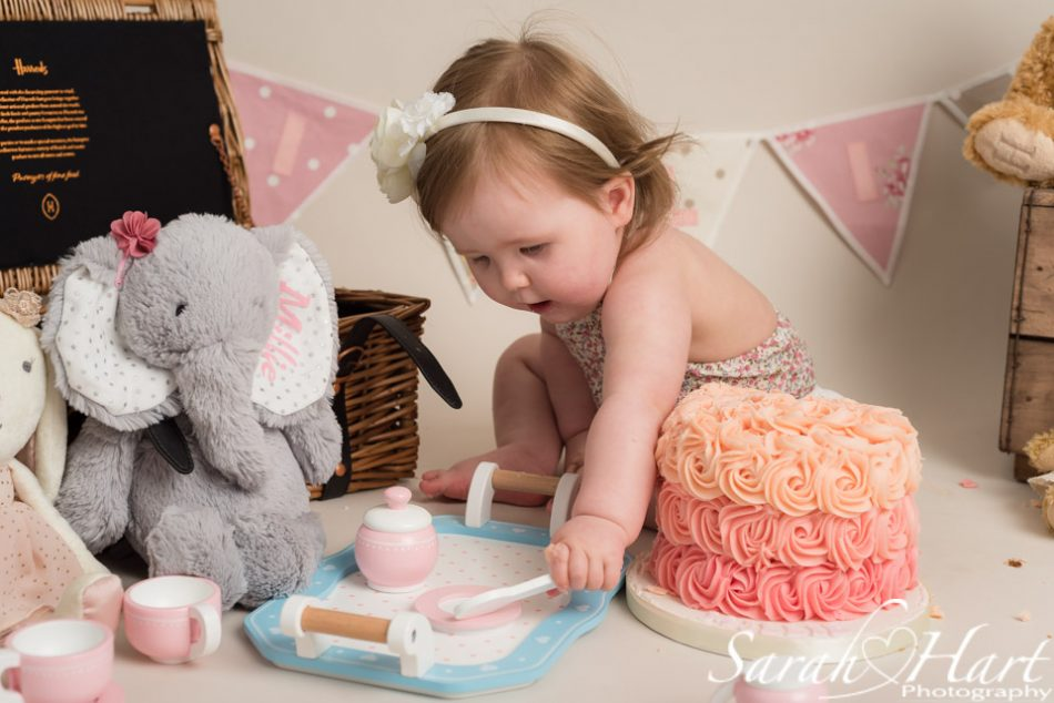Using her tea set at a teddy bears picnic cake smash, kent photographer
