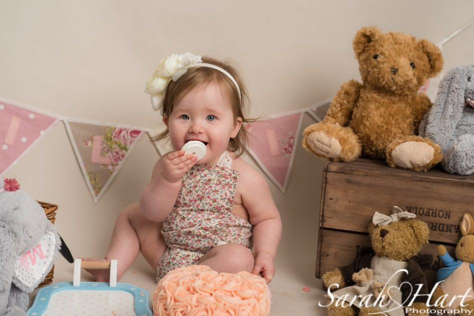 Little girl enjoying her cake smash party, Tunbridge wells cake smash photographer