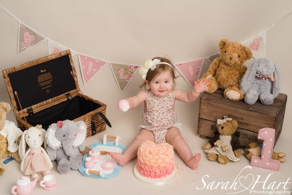 Little girl at her teddy bear's picnic cake smash, by Tonbridge photographer