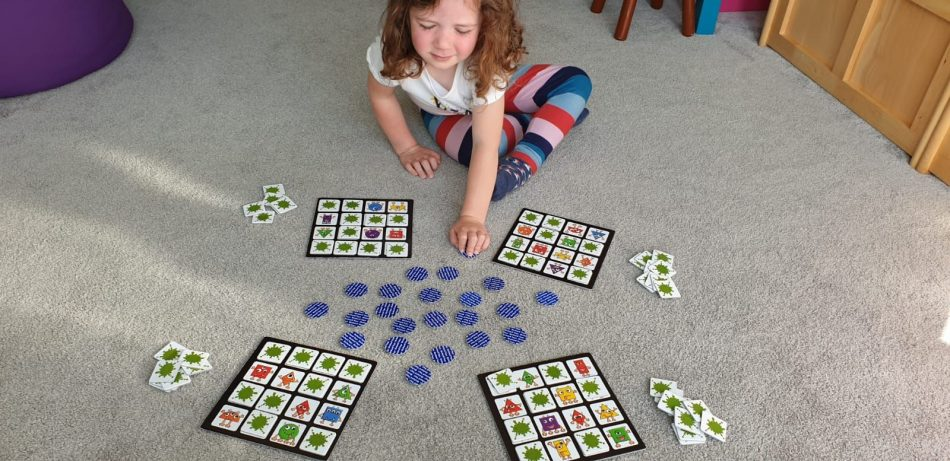 Preschooler playing a board game