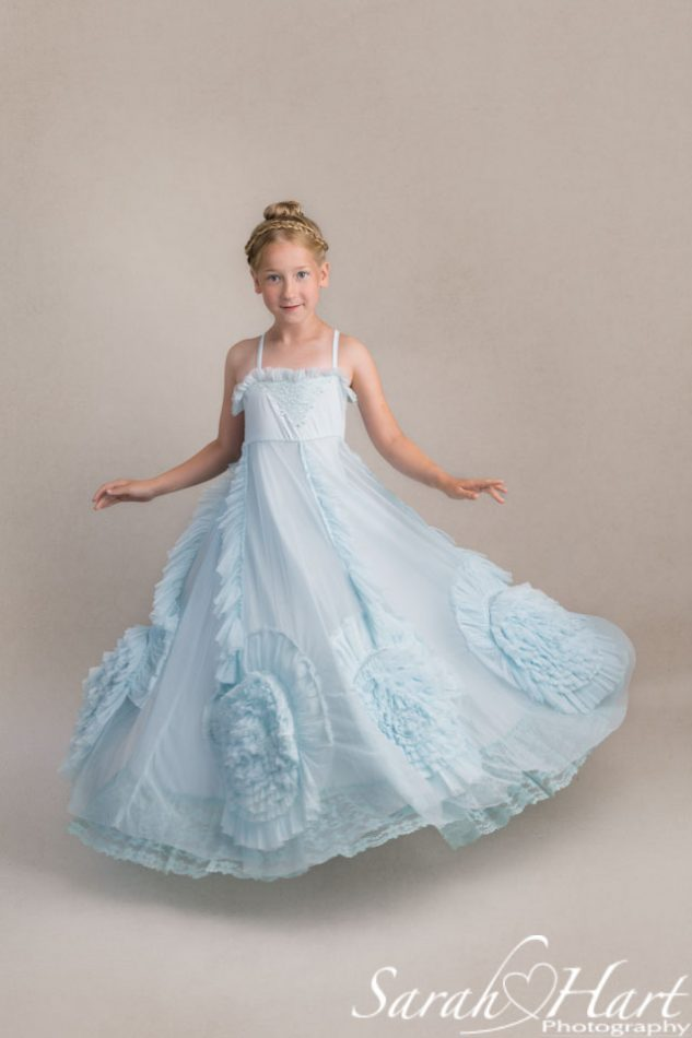Cinderella style dress, girl twirling and dancing, Tonbridge children photographer