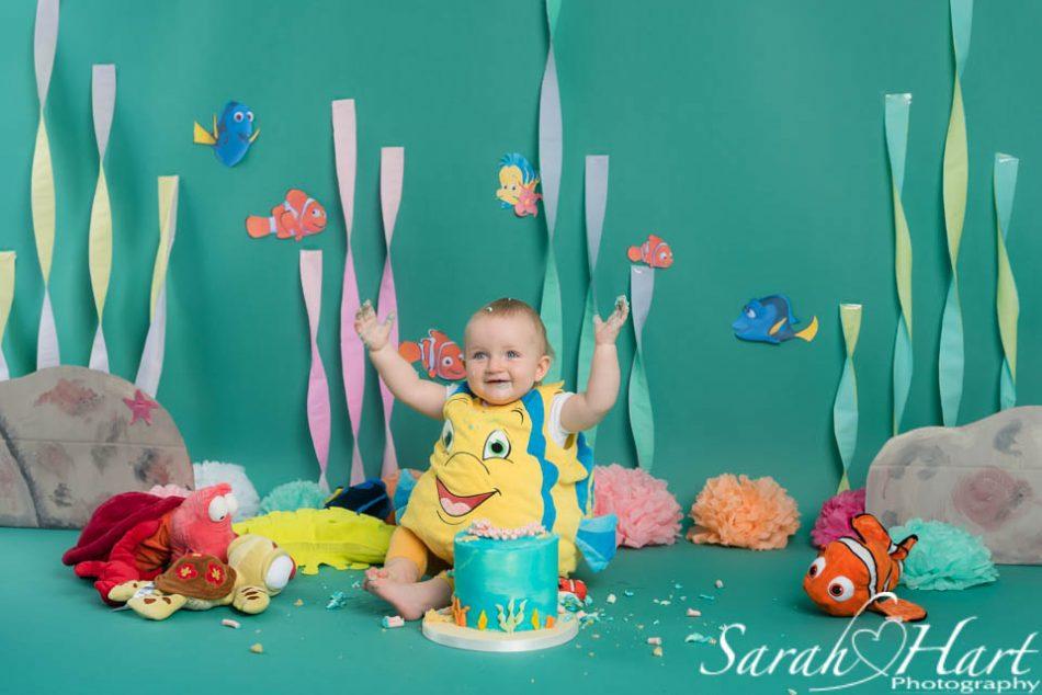 baby girl celebrates turning one with an under the sea theme cake smash, sevenoaks photographer