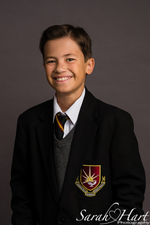 A school portrait of a secondary school pupil with a grey backdrop, taken by a Tunbridge wells photographer