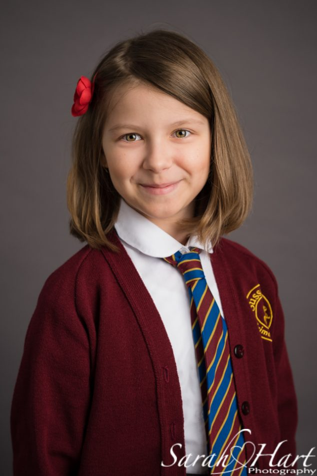 a simple school portrait of a young girl in a photography studio in kent