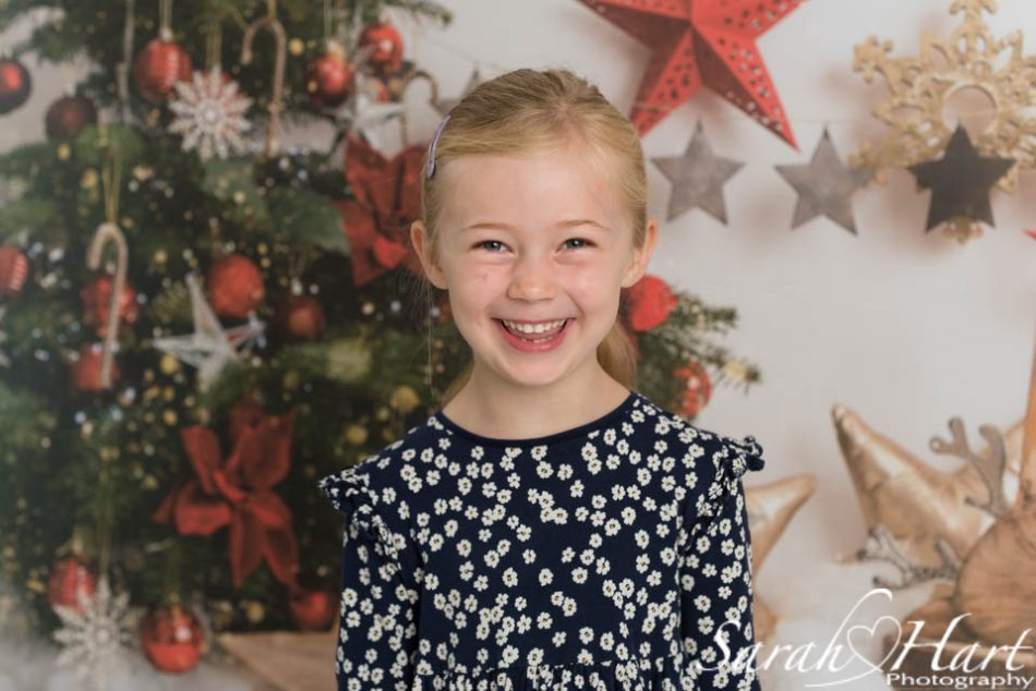 Girl smiling at her Xmas mini photoshoot